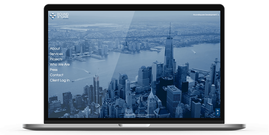 Laptop display of website for RoundSquare Builders