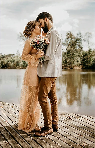 photo of young coupe embracing on a dock