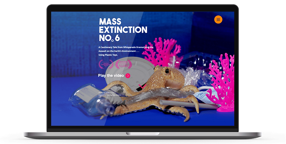 Laptop display of website for Mass Extinction No 6