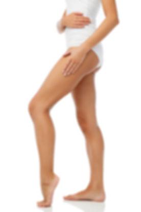 legs-of-beautiful-young-woman-in-white-u