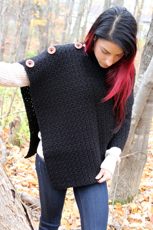 d2bb9c228aa97 This gorgeous Hailey Poncho is made from a beautiful blend of acrylic and  wool fibers which also includes three wooden buttons. The quality and feel  of this ...