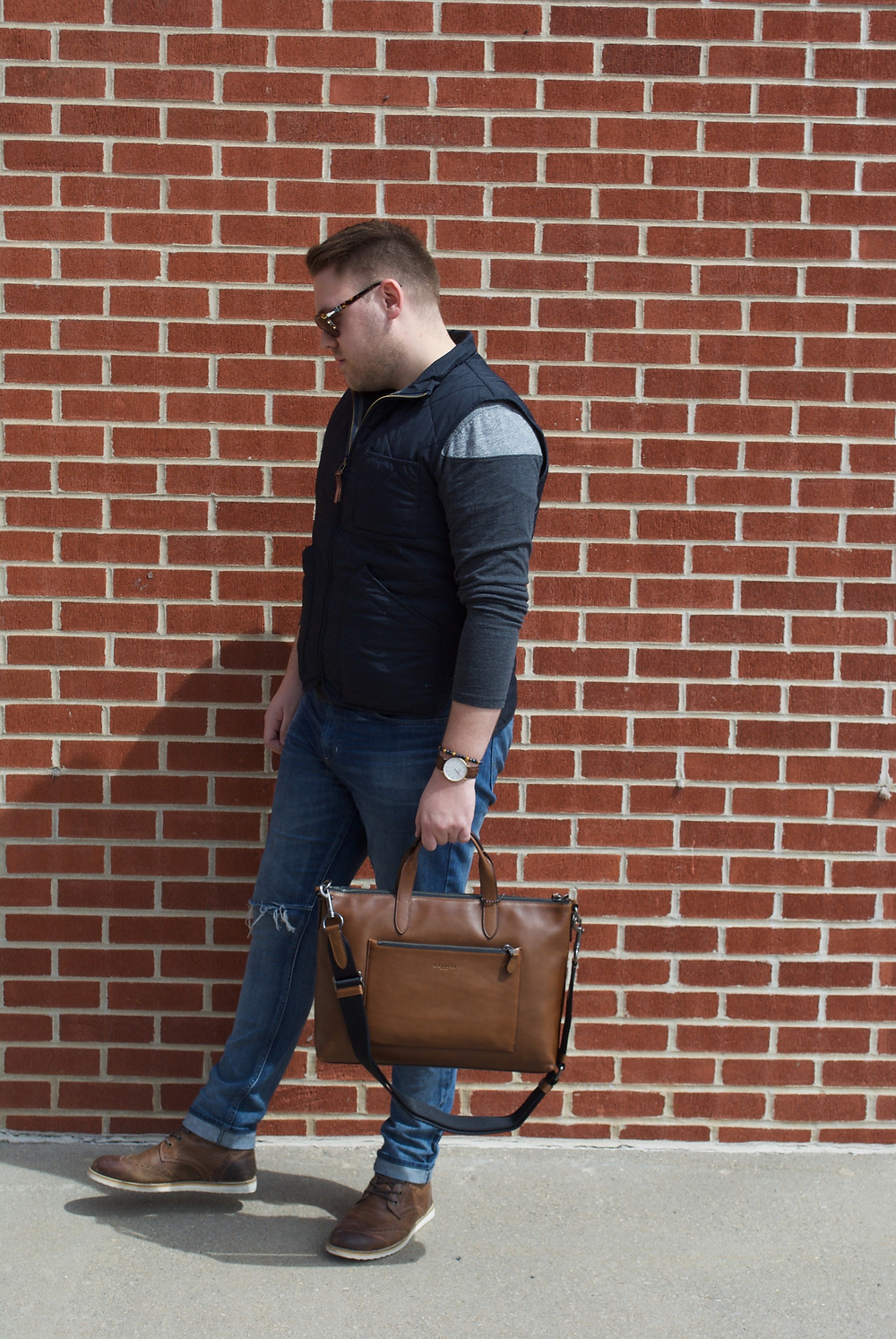 mens blog, outfit features distressed denim, Persol sunglasses, wingtip boots, Coach briefcase