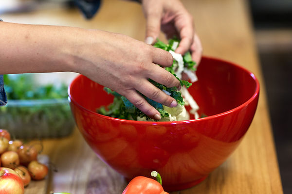 Hands creating salad.jpg