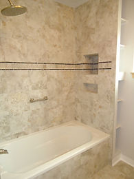Porcelain tile that looks like marble shower surround and niche by ABQ Art Glass