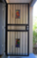Stained glass inserts for wrought iron security door by ABQ Art Glass