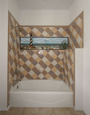 Lighthouse mosaic shower surround by ABQ Art Glass