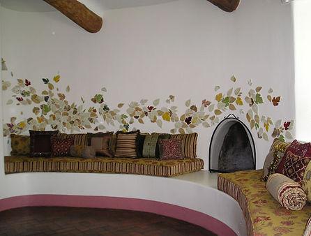 Mosaic leaves tile kiva fireplace by ABQ Art Glass