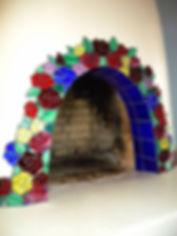 Mosaic glass roses kiva fireplace.
