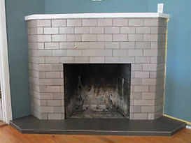 Light gray subway tile fireplace by ABQ Art Glass