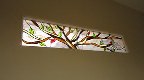 Tree stained glass by ABQ Art Glass.