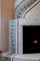 Stone mosaic kiva fireplace by ABQ Art Glass