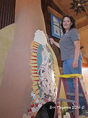 Erin Magennis installing Our Lady of Guadalupe mosaic located at Church Street Cafe