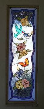 Hummingbird and Butterfly stained glass side light by ABQ Art Glass