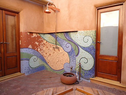 Swirly mosaic exterior shower by ABQ Art Glass