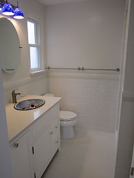 White tile bathroom by ABQ Art Glass