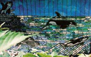 Glass mosaic of Alaska, painted great white whale.