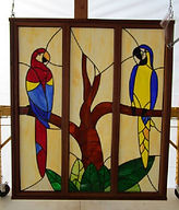 Parrot stained glass repair