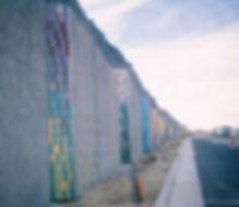Tile installation for concrete esacarpment barrier Unser Blvd. Albuquerque by ABQ Art Glass