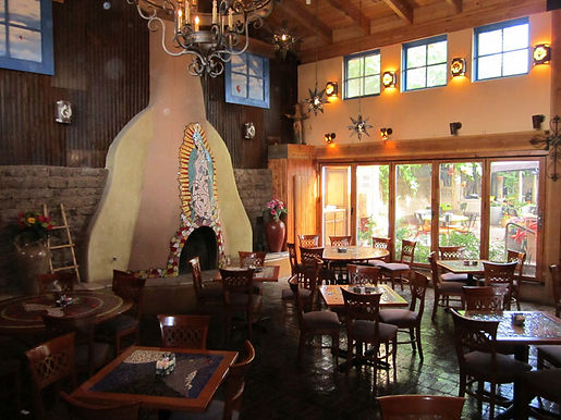 Our Lady of Guadalupe mosaic tile kiva fireplace located at Church Street Cafe by ABQ Art Glass
