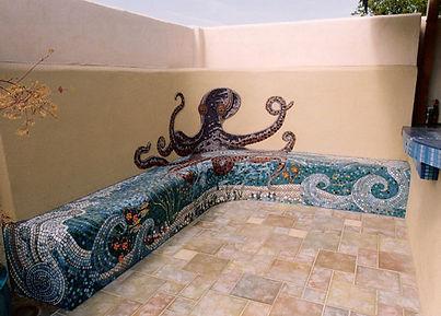 Mosaic octopus pool wall.