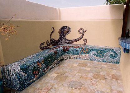 Mosaic octopus pool wall.