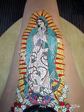 Our Lady of Guadalupe mosaic tile kiva fireplace by ABQ Art Glass