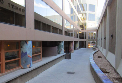 The Parade mosaic pillars located at the University Hospital of New Mexico by Beverley Magennis