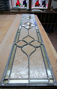 Clear beveled glass with glue chip.