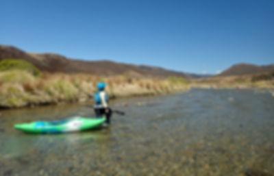 Kayaker walking on the Upper Ngaruroro river