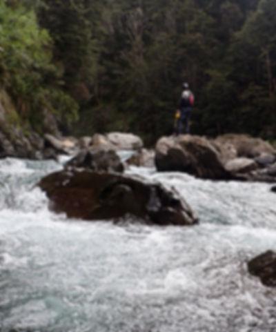 Kayaker setting saftey on the upper Ngaruroro river