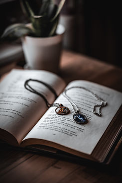 Harry Potter pendants and book.