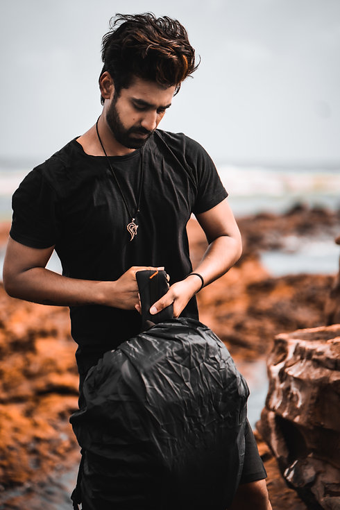 Aman Agrawal as a filmmaker with camera bag