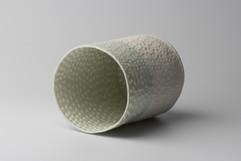Porcelain pierced vessel, side view