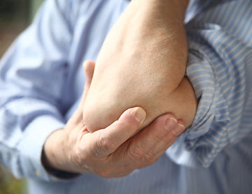 Tennis elbow pain treatment in London.jp