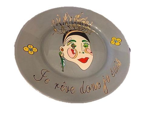 """je rêve donc de suis"" Grey handmade plate by the designer Sara Melki ."