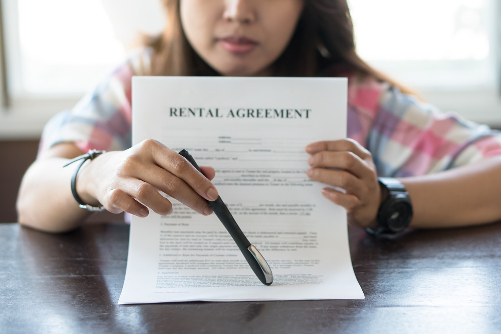 Landlord reviewing lease agreement with a tenant