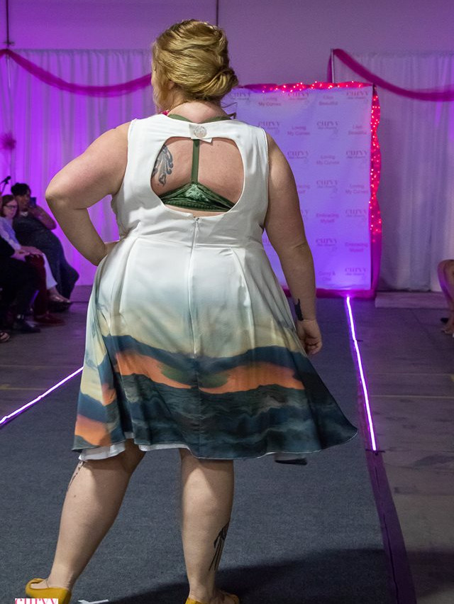 Lou shows off her back in the Angel dress