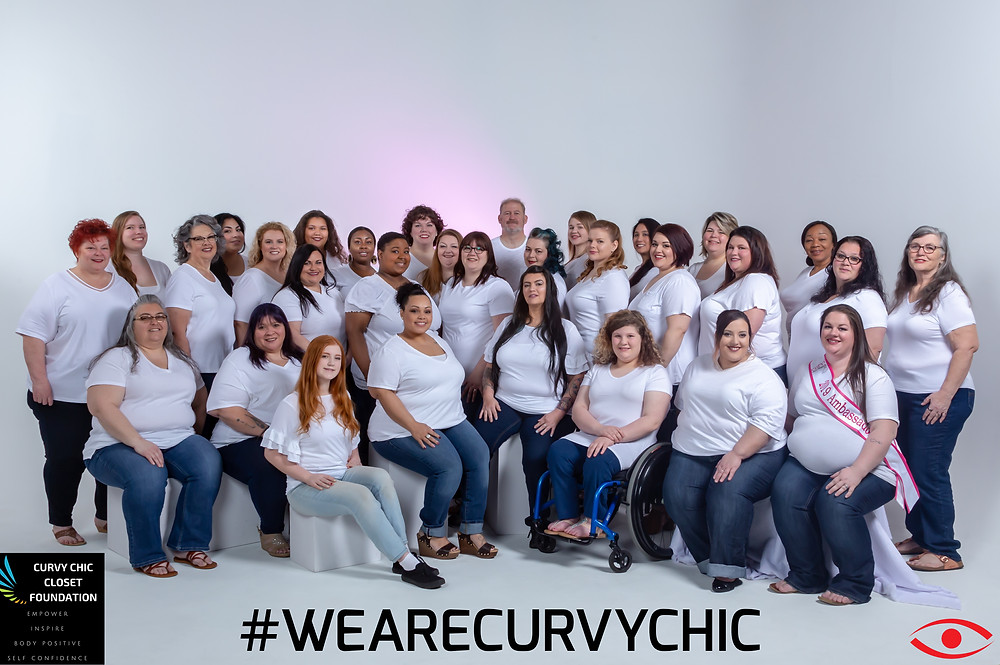 Plus size women in white tees and denim are grouped together. The hashtag at the bottom of the image is #wearecurvychic