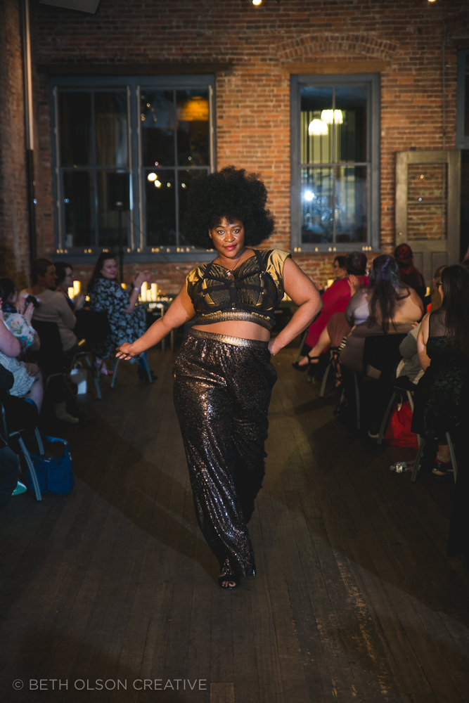 Yolanda werks that runway in a look from Belle Ampleur, and a harness from Bawdy Love