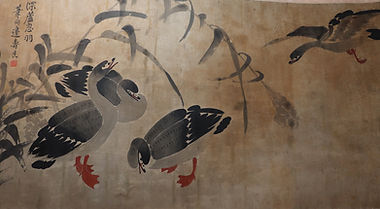 Polychrome painting on paper depicting wild geese among reeds, one in flight