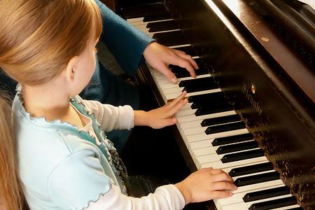 Elemenary Piano Student Hands on Keys