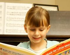 Elementary Piano Student Girl
