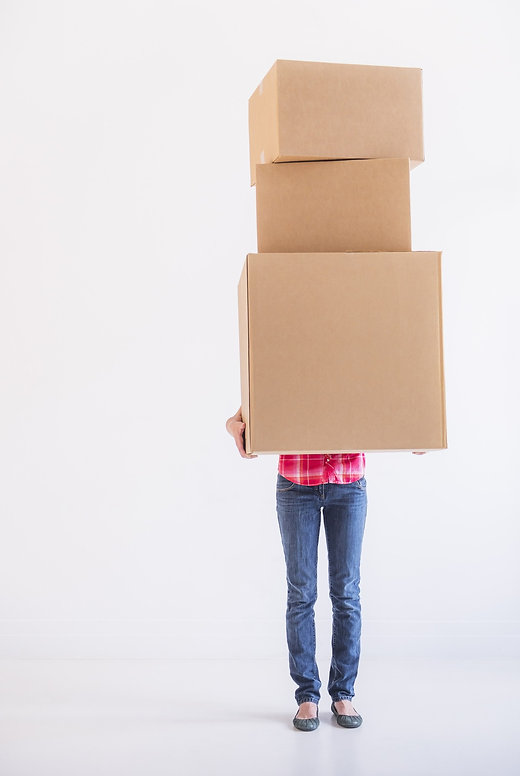 woman carrying stack of boxes_edited.jpg