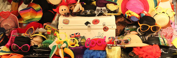 An amazing selection of photo booth props including hats, glasses, wigs and scarves with a classic vintage prop box.