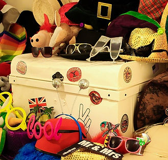 An amazing selection of photo booth props including hats, glasses, wigs and scarves with a classic vintage prop box; available with any photobooth hire package.