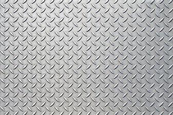 Metal floor plate with diamond pattern..