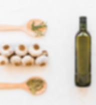 row-of-black-olives-with-oil-bottle-garl