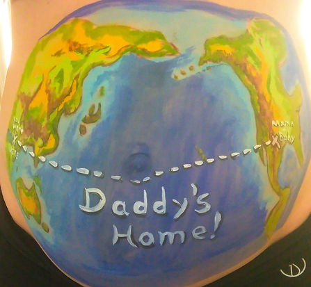 Maternity belly paint for a military family whose husband was returning from deployment.