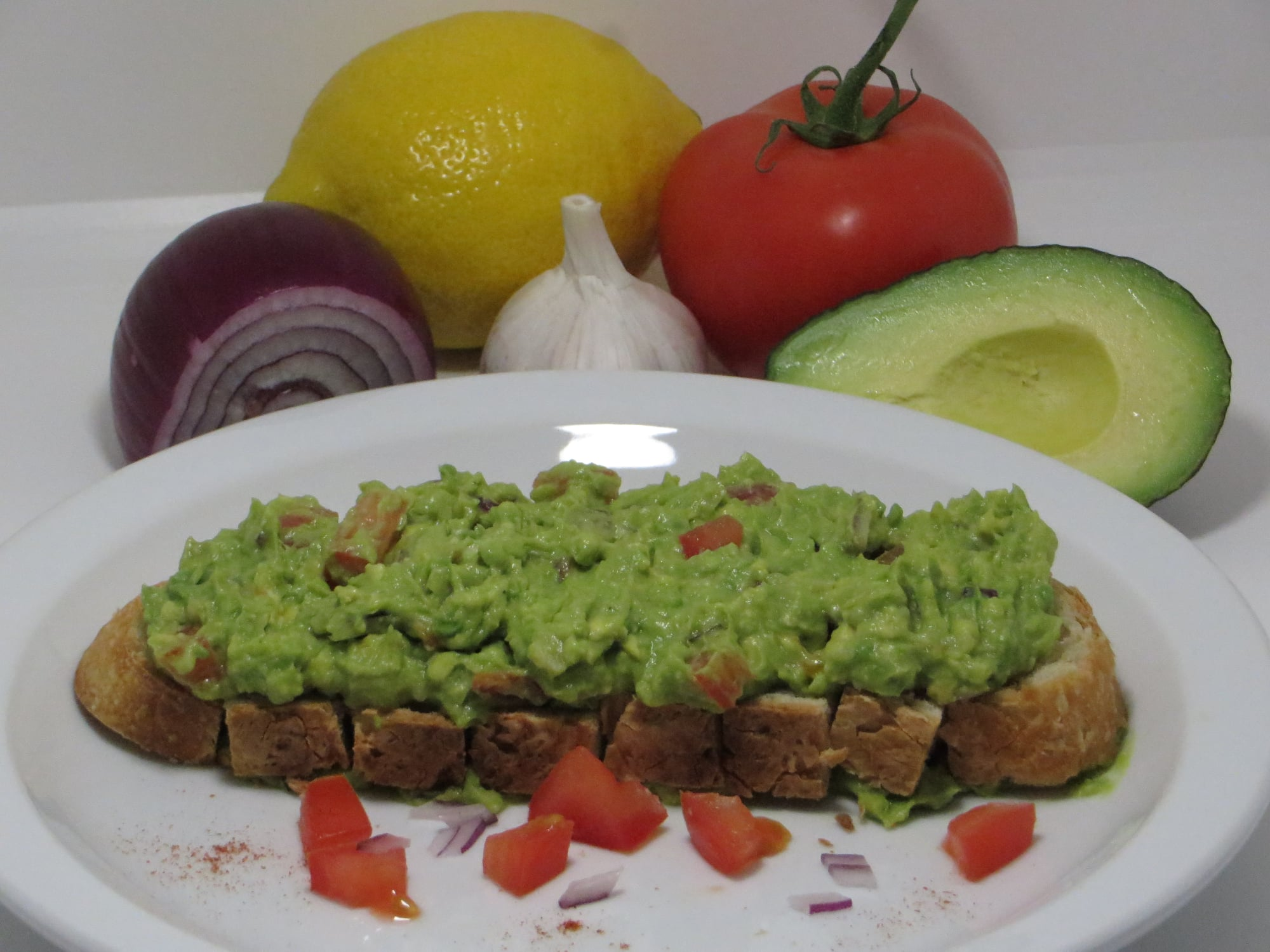 Avocado-Guacamole (Onion, Tomato, Garlic, Lemon) on Toast