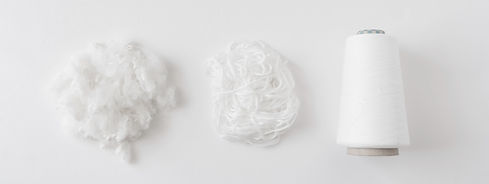 top view of Textile industry concept with yarn spools, fiber and Wool Roving on white back